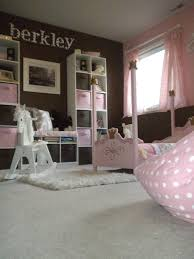 pink and brown little girls princess room / playroom. This serene kids room  is one