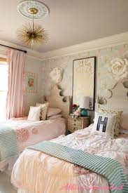 if you re decorating a room for two little girls take inspiration from this girls bedroom featuring lovely rose wall decorations and an artistic hanging