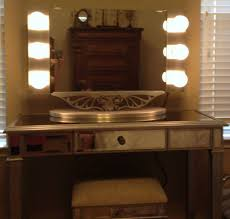 image of vanity table with lighted mirror