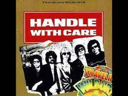 handle with care traveling wilburys