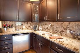 backsplash ideas for kitchens with granite countertops and brown cabinet color