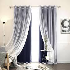 features set includes 2 blackout curtain panels and 2 white sheer curtain panels