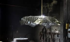 this is a modern and unique ceiling lamp designed by andreu carulla studio they started from a flat sheet of triangles and then create the geometry model