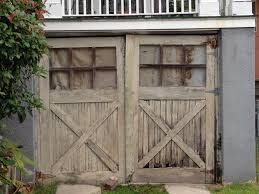 infinitely more charming than rows and rows of nondescript overhead doors of today yes these wood built lashed doors are what the best of garage doors