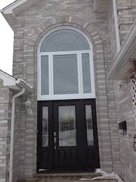 fiberglass door with round top windows above