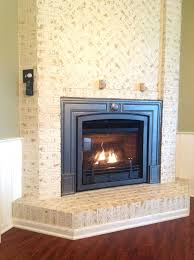 brick gas fireplace valor horizon log fire gas direct vent fireplace or insert installed with door front red brick liner and vintage iron cast surround