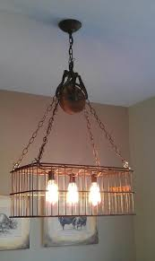 repurposed lighting. Repurposed Light Fixture Made Of Vintage Basket, Barn Pulley And Edison Lamps. Lighting U
