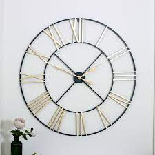 gold skeleton wall clock