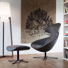contributed to tonon s designs which meld contemporary timelessness with ergonomics and always quality behind every innovative upholstered chair or