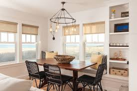 scalloped roller shades with beach style dining room and beach cottage black dining chair built in bench builtin shelves chandelier coastal cottage