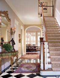 stair runner and two oriental rugs in entryway