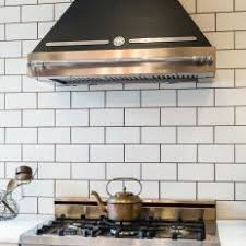 Dark Grout Defines White Subway Tile Backsplash