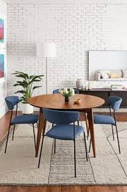 create a modern dining room with a round extension table and upholstered dining chairs