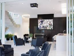 Interior:Charming Modern Media Room Design With Double Side Grey Sofa And  Stripes Curtains Also