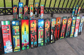 planks painted by ricco rideaux line the gate in front of jackson square in new orleans