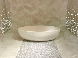 free standing bathtub oval natural stone