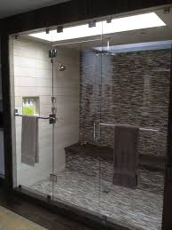 inline panel door panel in 1 2 and 3 8 clear glass with hinged transom above door this unit also features two towel bars on either panel