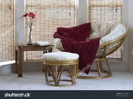 Papasan Chair In Living Room Papasan Chair Stool Coffee Table Flowers Stock Photo 1548666