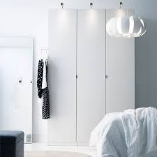 ikea pax wardrobe lighting. small white three door pax wardrobe in a bright room ikea pax lighting