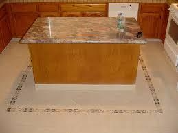 pink granite countertop on oak cabinets