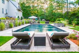 Rectangle pool Hot Tub Linear Pool With Stone Planter Environmental Pools Swimming Pool Photo Gallery Pool Construction By Environmental Pools
