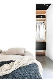 bedroom with walk in closet behind bed maja by deko