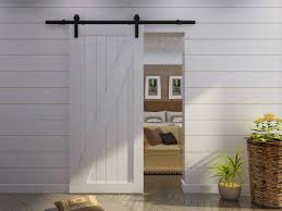 dashing barn door design ideas features white color wooden barn door and single sliding barn door