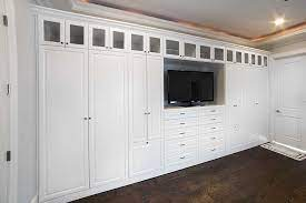 custom wall unit storage for the bedroom