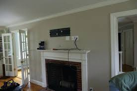 gas fireplace tv mounted above over traditional living room idea in with beige walls