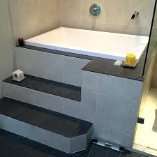 bathtub with built in steps the calyx shown in its surround with built in step bathtub bathtub with built in steps