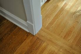 trim work transition with wood plank tile transition ideas hardwood floor transition from room