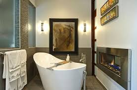 beautiful small spa bathroom design with stylish white bathtub also modern firepit and grey wall plus decorative canvas painting