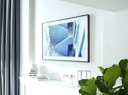 wall frames frame displaying photo realistic artwork on a white painted above fireplace mounting tv flat