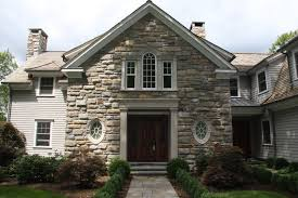 exterior stone facade. the exterior of house, which is given by decoration stone . facade n