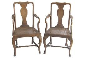 vintage french caned wooden arm chairs pair