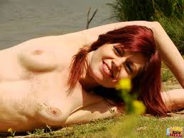 Nude Beach Dreams A Sexy Redhead Gets Nude At The Beach And Shows.