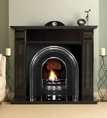 arched black and metal fireplace in dark wood mantelpiece