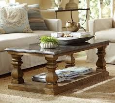 elegant pottery barn round coffee table with golden boye