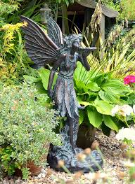 garden statue with aged verde finish cast in resin height 95 cm