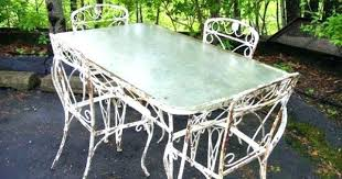 Antique iron patio furniture Salterini Wroght Iron Patio Attractive Antique Wrought Iron Patio Furniture House Decorating Photos Chairs Table And On Lawn Outside Pa Wrought Iron Patio Chairs With Eva Furniture Wroght Iron Patio Attractive Antique Wrought Iron Patio Furniture