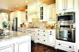 backsplash white cabinets stone more best white kitchen cabinets kitchen backsplash white cabinets black countertop