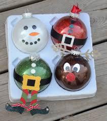 Glass ball ornaments - cute wy to decorate those DIY glitter ornaments made  w/Pledge floor wax!