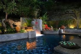 tropical outdoor lighting. modern outdoor fountains pool tropical with lighting concrete wall a