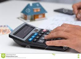 Household Expenses Calculator Hand On Calculator Calculating Household Expenses Stock