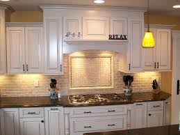kitchen white wooden kitchen cabinet with black counter top and stove also cream tile back