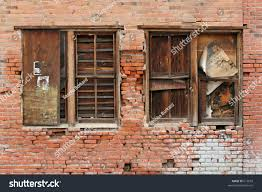 Exterior Brick Wall Crumbling Two Old Wooden Windows In A