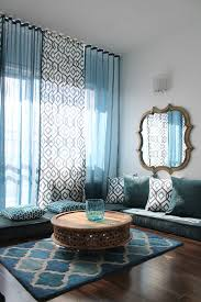 a colorful moroccan living room with blue curtains and yellow dresser gnuarch org houzz com
