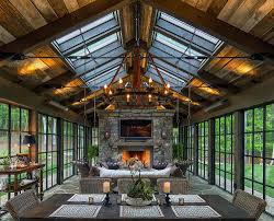 view in gallery skylights bring in additional ventilation into the stunning rustic sunroom design ina timberworks