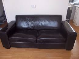 large dark brown leather sofa very clean and tidy 3 seater see full
