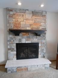 mendota fv44 gas fireplace insert with diamond back ledgestone and reclaimed mantel